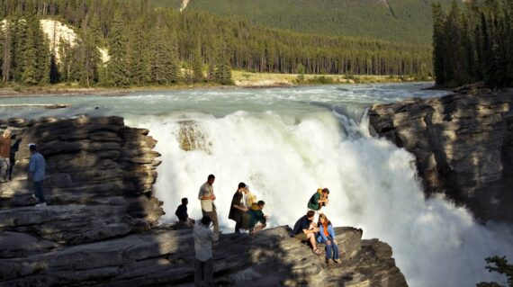 Athabasca Falls and river is one of many interesting spots in Canadian Rockies. In the back is Mount Kerkeslin