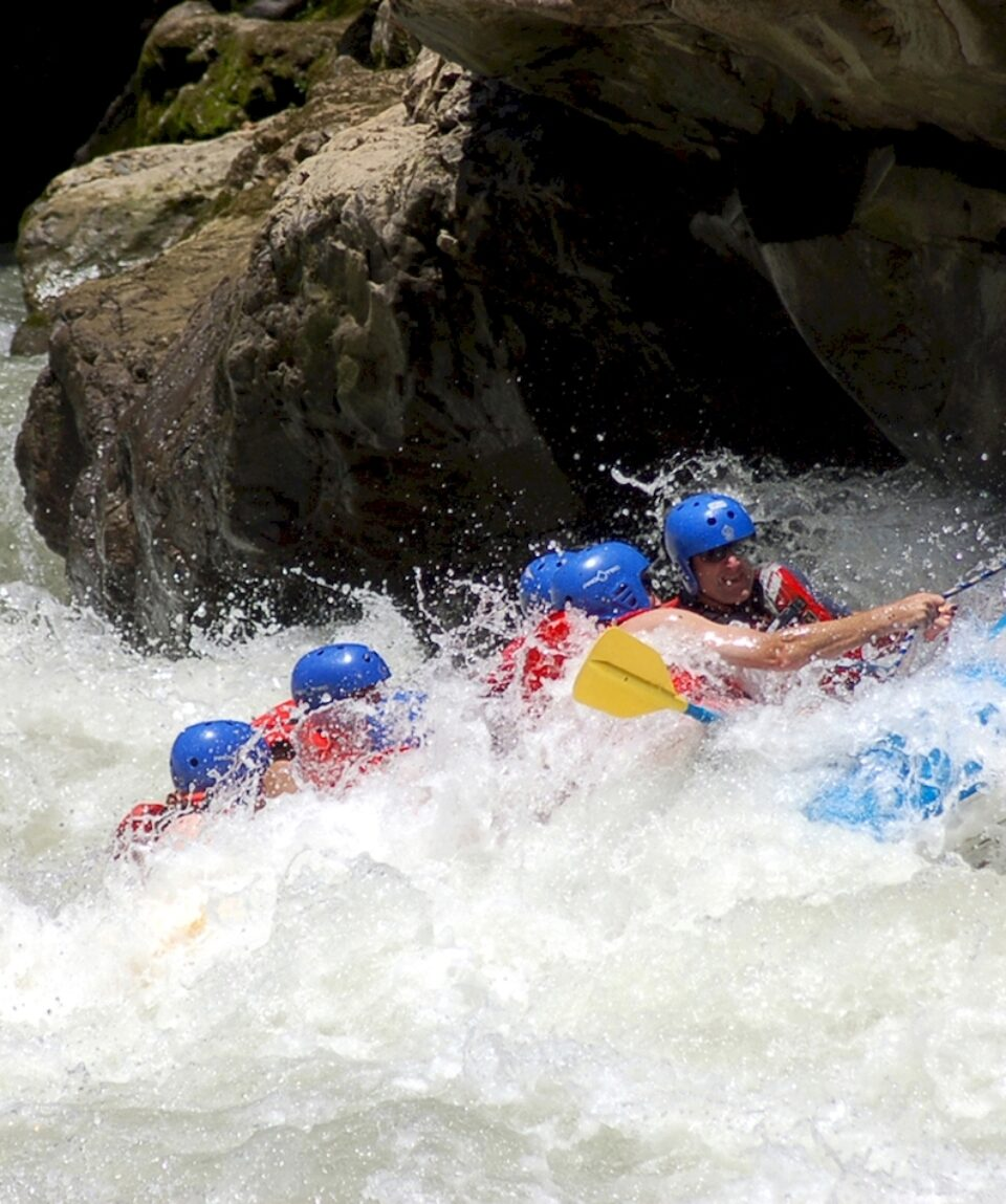 Rising from the waves. Whitewater rafting.