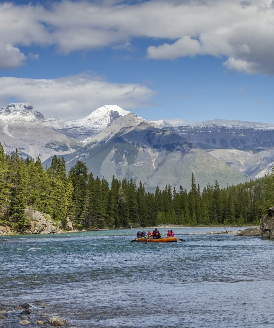 River float on the Athabasca River with the Rocky Mountains in the background - Jasper National Park